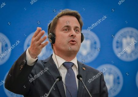Luxembourg Premier Xavier Bettel gestures during joint statements with Romanian counterpart Sorin Grindeanu in Bucharest, Romania, . The prime minister of Luxembourg has urged Romania to speedily resolve a political crisis sparked when the ruling party withdrew support for the prime minister who then refused to step down