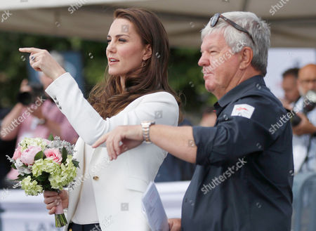 Catherine Duchess of Cambridge is welcomed by Keith Mills as she arrives to attend the charity's final Land Rover BAR Roadshow