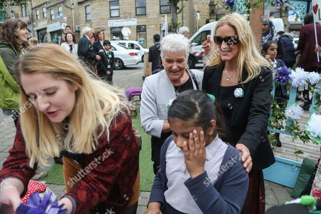 Jo Cox's mother Jean Leadbeater and sister Kim Leadbeater talk to members of the community in Birstall town square where the Labour MP was murdered a year ago today