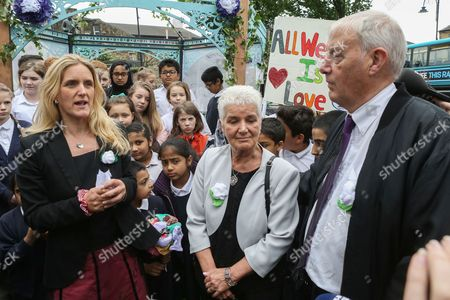 Jo Cox's sister Kim Leadbeater, mother Jean Leadbeater and father Gordon Leadbeater along with members of the local community gather in Birstall town square where the Labour MP was murdered a year ago today