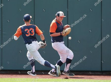 Hunter Cullen, John Gavin Cal State Fullerton outfielder Hunter Cullen (33) and pitcher John Gavin chase a fly ball during team practice in Omaha, Neb., . Cal State Fullerton plays Oregon State in the NCAA baseball College World Series on Saturday