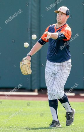 Stock Picture of Cal State Fullerton pitcher John Gavin tosses two balls during team practice in Omaha, Neb., . Cal State Fullerton plays Oregon State in the NCAA baseball College World Series on Saturday