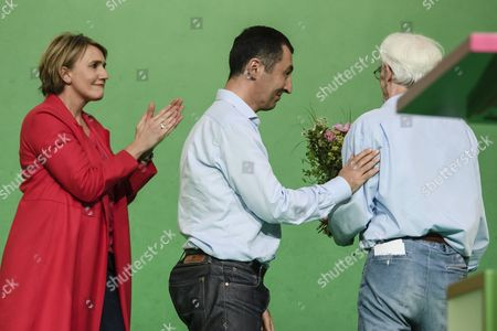 The Parliamentarian Hans-Christian Stroebele (R) receive flowers from the Federal Chairman and top candidate for the upcoming Federal Election in Germany, Cem Ozdemir, (C) and co-top candidate for the upcoming Federal Elections in Germany, Katrin Goering-Eckardt (L), during the Delegate Conference of the German Alliance 90/The Greens (Buendnis 90/Die Gruenen) Party at the Velodrom in Berlin, Germany, 16 June 2017. The German Alliance 90/The Greens (Buendnis 90/Die Gruenen) Party is having its 41st Federal Delegate Conference from 16 to 18 June 2017 in Berlin.