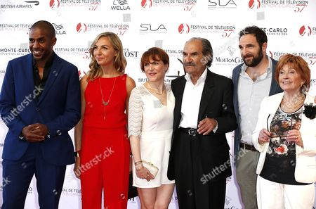 (L-R) French actors Loup Denis Elion, Amelie Etasse, Anne Elisabeth Blateau, Gerard Hernadez, David Mora and Marion Game from the TV series 'Scenes de menages' pose on the red carpet while arriving for the opening ceremony of the 57th Monte Carlo Television Festival in Monaco, 16 June 2017. The event will take place from 16 to 20 June.