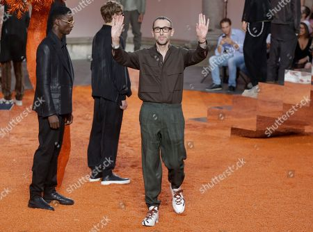 Fashion designer Alessandro Sartori waves at the end of the presentation of the Ermenegildo Zegna men's Spring-Summer 2018 collection, in Milan, Italy