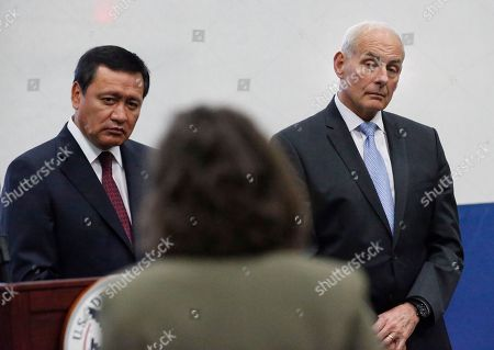 Miguel Angel Osorio Chong, John Kelly U.S. Secretary of Homeland Security (DHS), John Kelly, right, and Mexican Secretary of Interior, Miguel Angel Osorio Chong listen to a question during a news conference at the close of a conference on Prosperity and Security in Central America at the U.S. Southern Command, in Doral, Fla