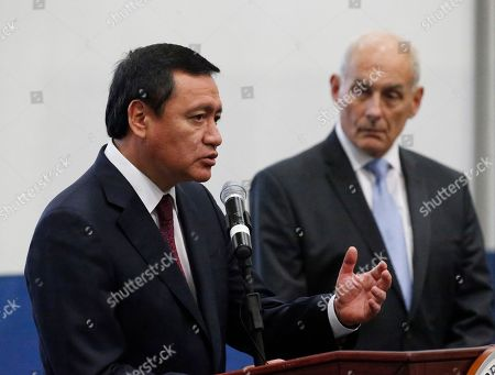 Miguel Angel Osorio Chong, John Kelly Mexican Secretary of Interior, Miguel Angel Osorio Chong, left, gestures as he speaks as U.S. Secretary of Homeland Security (DHS), John Kelly, right, looks on during a news conference at the close of a conference on Prosperity and Security in Central America at the U.S. Southern Command, in Doral, Fla