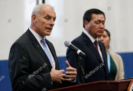 Miguel Angel Osorio Chong, John Kelly U.S. Secretary of Homeland Security (DHS), John Kelly, left, gestures as he speaks as Mexican Secretary of Interior, Miguel Angel Osorio Chong looks on during a news conference at the close of a conference on Prosperity and Security in Central America at the U.S. Southern Command, in Doral, Fla
