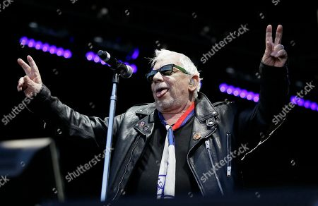 "Eric Burdon performs during the Monterey International Pop Festival, in Monterey, Calif. The festival turned 50 on Friday and celebrated its anniversary by kicking off another three-day concert that's bringing back a few acts from half a century ago. In 1967 the festival was the centerpiece of the ""Summer of Love."" Burdon performed at the first festival"