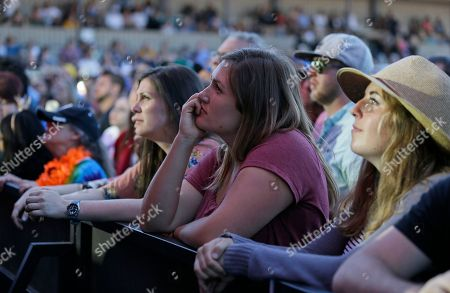 "People listen to Eric Burdon and the Animals perform during the Monterey International Pop Festival, in Monterey, Calif. The festival turned 50 on Friday and celebrated its anniversary by kicking off another three-day concert that's bringing back a few acts from half a century ago. In 1967 the festival was the centerpiece of the ""Summer of Love."" Burdon performed at the first festival"