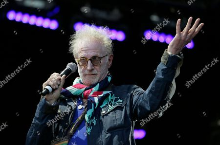 "Stock Picture of Andrew Oldham, former manager of the Rolling Stones, gestures while introducing Eric Burdon and the Animals during the Monterey International Pop Festival, in Monterey, Calif. The festival turned 50 on Friday and celebrated its anniversary by kicking off another three-day concert that's bringing back a few acts from half a century ago. In 1967 the festival was the centerpiece of the ""Summer of Love."" Burdon performed at the first festival. Burdon played in the first festival that Oldham helped produce"