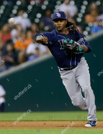 Stock Photo of Tampa Bay Rays third baseman Michael Martinez throws out Detroit Tigers' Justin Upton at first base during the eighth inning of a baseball game, in Detroit