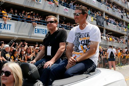 Ron Burkle, Mario Lemieux Pittsburgh Penguins owners Mario Lemieux, right, and Ron Burkle ride in the Stanley Cup victory parade in Pittsburgh