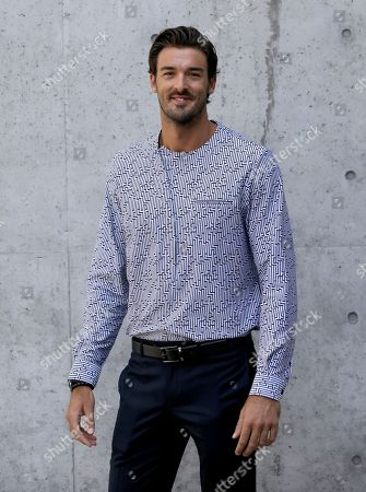 Italian Olympic volleyball player Alex Ranghieri attends the men's Spring-Summer 2018 collection, in Milan, Italy