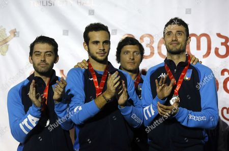 Members of the Italian national team Enrico Berre, Luca Curatoli, Aldo Montano and Luigi Samele celebrate with their silver medals in the men's team Saber final at the European Fencing Senior Championships in Tbilisi, Georgia, 17 June 2017.