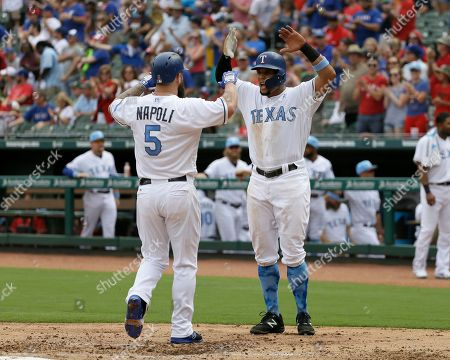 Carlos Gomez, Mike Napoli Texas Rangers' Mike Napoli (5) and Carlos Gomez, right, celebrate Napoli's two-run home run that came off a pitch from Seattle Mariners starting pitcher Yovani Gallardo in the first inning of a baseball game, in Arlington, Texas