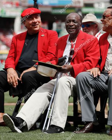 Former Cincinnati Reds player Joe Morgan waves to the crowd as he attends a statue dedication ceremony for teammate Pete Rose before a baseball game between the Cincinnati Reds and the Los Angeles Dodgers, in Cincinnati