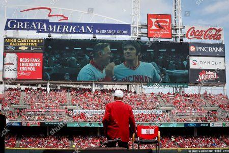 Former Cincinnati Reds player Pete Rose watches himself on the big screen during his statue dedication ceremonies before a baseball game between the Cincinnati Reds and the Los Angeles Dodgers, in Cincinnati