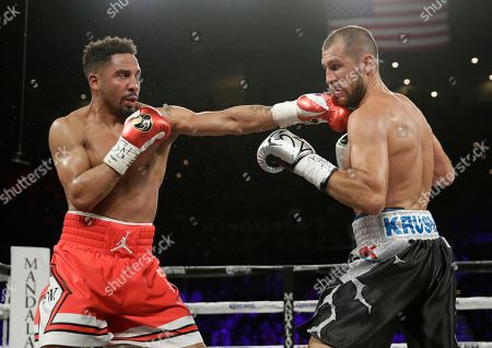 Andre Ward, left, fights Sergey Kovalev during a light heavyweight championship boxing match, in Las Vegas