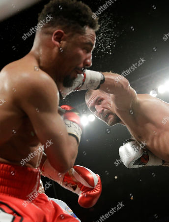 Sergey Kovalev punches Andre Ward during a light heavyweight championship boxing match, in Las Vegas
