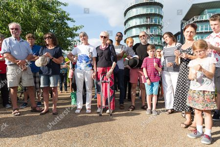People attending The Great Get Together. Neighbours and friends of Jo Cox attend The Great Get Together near Hermitage Moorings in Wapping to pay tribute and celebrate Jo's call that more unites us than divides us on the anniversary of her death. Jo Cox lived on a house boat in Wapping with her husband Brendan Cox and two children.