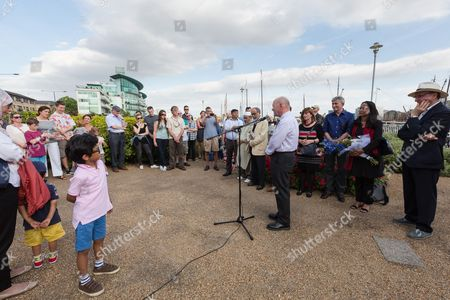 John Biggs, Mayor of Tower Hamlets speaking at The Great Get Together. Neighbours and friends of Jo Cox attend The Great Get Together near Hermitage Moorings in Wapping to pay tribute and celebrate Jo's call that more unites us than divides us on the anniversary of her death. Jo Cox lived on a house boat in Wapping with her husband Brendan Cox and two children.