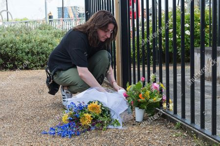 A friend lays flowers for Jo Cox. Neighbours and friends of Jo Cox attend The Great Get Together near Hermitage Moorings in Wapping to pay tribute and celebrate Jo's call that more unites us than divides us on the anniversary of her death. Jo Cox lived on a house boat in Wapping with her husband Brendan Cox and two children.