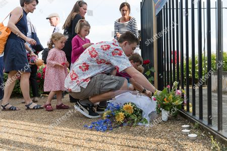 Fiends lay flowers for Jo Cox. Neighbours and friends of Jo Cox attend The Great Get Together near Hermitage Moorings in Wapping to pay tribute and celebrate Jo's call that more unites us than divides us on the anniversary of her death. Jo Cox lived on a house boat in Wapping with her husband Brendan Cox and two children.