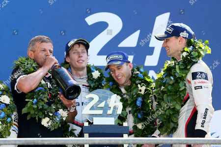 Fritz Enzinger, president of Porsche Team, left, celebrates with drivers Brendon Hartley, Earl Bamber and Timo Bernhard during the podium ceremony of the 85th 24-hour Le Mans endurance race, in Le Mans, western France