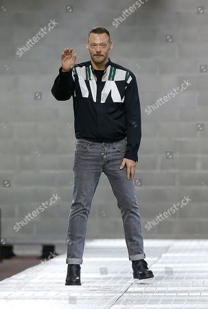 Creative Director Lee Wood waves to the audience at the end of the Dirk Bikkembergs men's Spring-Summer 2018 fashion show, that was presented in Milan, Italy