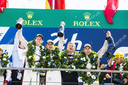 Stock Image of Porsche Team LMP1 drivers Timo BERNHARD DEU, Earl BAMBER NZL, Brendon HARTLEY NZL, celebrate after winning the 24 Hours of Le Mans 2017 race at Le Mans, Le Mans
