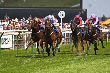 Winner of The Think Cars Ssangyong Paddock Area Display Handicap,Edged Out (nearside)ridden by Mitch Godwin and trained by Christopher Mason during Father's Day Racing at Salisbury Racecourse on 18th June 2017