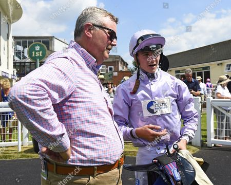Trainer Christopher Mason (l) and jockey Mitch Godwin confer in the winners enclosure after winning The Think Cars Ssangyong Paddock Area Display Handicap, during Father's Day Racing at Salisbury Racecourse on 18th June 2017