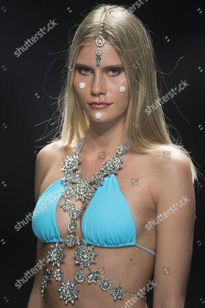 Model Lotta Korkala poses on the catwalk