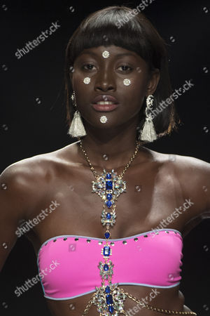Model Aya Gueye poses on the catwalk