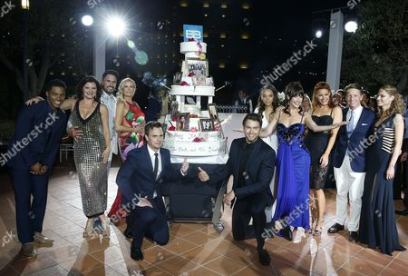 US actors of TV series 'The Bold and The Beautiful' (L-R) Rome Flynn, Heather Tom, Don Diamont, Katherine Kelly Lang, Darin Brooks, Pierson Fode, Reign Edwards, Jacqueline MacInnes Wood, Courtney Hope, US producer Bradley Bell and Kelly Kruger pose with a cake of the 30th Years Anniversary of 'The Bold and The Beautiful' during the 57th Monte Carlo Television Festival in Monaco, 18 June 2017.