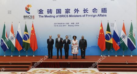 Brazil's Foreign Minister Aloysio Nunes (L), Russia's Foreign Minister Sergey Lavrov (2-L), South Africa's Foreign Minister Maite Nkoana-Mashabane (2-R) and Indian Minister of External Affairs Vijay Kumar Singh (R) pose with China's Foreign Minister Wang Yi (C) before the opening of the BRICS (Brazil, Russia, India, China and South Africa) Foreign Ministers meeting in Beijing, China, 19 June 2017.