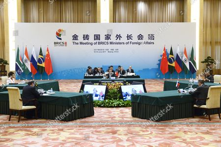 Brazil's Foreign Minister Aloysio Nunes (L-2), Russia's Foreign Minister Sergey Lavrov (R-2), South Africa's Foreign Minister Maite Nkoana-Mashabane (L), Indian Minister of External Affairs Vijay Kumar Singh (R) and China's Foreign Minister Wang Yi (C) attend the BRICS Foreign Ministers meeting, which consists of representatives from five major emerging national economies; Brazil, Russia, India, China and South Africa, at the Great Hall of the People?s Fujian Room in Beijing on June 19, 2017. The five nations are using the meeting to discuss common issues of climate change, trade and terrorism.
