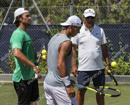 Spanish tennis player Rafa Nadal (C) stands between his coaches Toni Nadal (R) and Carlos Moya during a training session at the Mallorca Open tennis center in Palma Majorca, the Balearic Islands, Spain,  19 June 2017. The 15 time grand slam winner Rafa Nadal Nadal is preparing for the 2017 Wimbledon Championships that will be held at the All England Lawn Tennis and Croquet Club in Wimbledon from 03 July to 16 July.