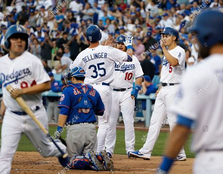 Cody Bellinger, Justin Turner, Corey Seager, Travis d'Arnaud Los Angeles Dodgers' Cody Bellinger(35) celebrates his three-run home run with Justin Turner (10) and Corey Seager(5) in front of New York Mets catcher Travis d'Arnaud during the first inning of a baseball game, in Los Angeles