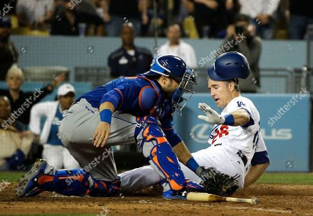 Travis d'Arnaud, Chase Utley Los Angeles Dodgers' Chase Utley, right, slides into home plate to score on a single by Justin Turner as New York Mets catcher Travis d'Arnaud fields the throw during the sixth inning of a baseball game, in Los Angeles