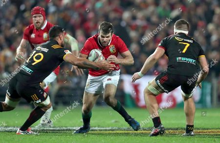 Chiefs vs British & Irish Lions. Lions' Jared Payne with Lachlan Boshier and Liam Messam of the Chiefs