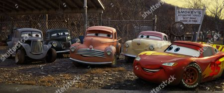 River Scott (Isiah Whitlock Jr.), Junior?Moon (Junior Johnson), Smokey (Chris Cooper), Louise Nash (Margo Martindale), and Lightning McQueen (Owen Wilson)