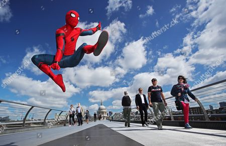 Spider-Man: Homecoming stunt double Chris Silcox wears the world famous Spidey suit and takes on London's iconic landmarks in striking photo shoot ahead of the film's 5th July cinema release.