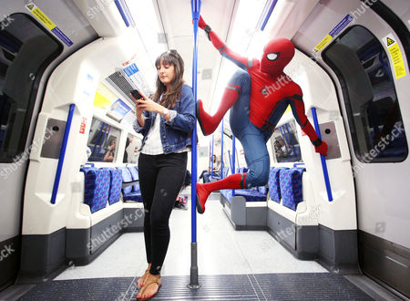 Stock Image of Stunt double Chris Silcox wears the Spidey suit in striking photo shoot
