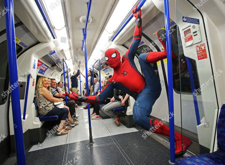 Stunt double Chris Silcox wears the Spidey suit in striking photo shoot
