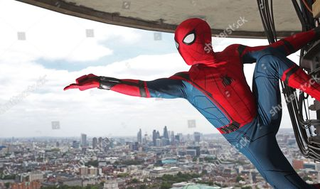 Spider-Man: Homecoming stunt double Chris Silcox, wearing one of the actual suits used in the new movie, is captured scaling the BT Tower and taking in the ultimate view of London. The stunt took place ahead of the 5th July release of Spider-Man: Homecoming.