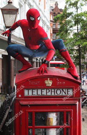 Stock Photo of Spider-Man: Homecoming stunt double Chris Silcox wears the world famous Spidey suit and takes on London's iconic landmarks in striking photo shoot ahead of the film's 5th July cinema release.