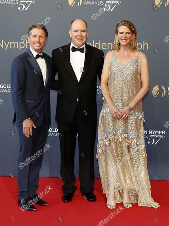 Prince Albert II of Monaco (C), US producer Bradley Bell (L) and his wife Colleen Bell (R) pose on the red carpet while arriving for the closing ceremony of the 57th Monte Carlo Television Festival in Monaco, 20 June 2017. The event runs from 16 to 20 June.