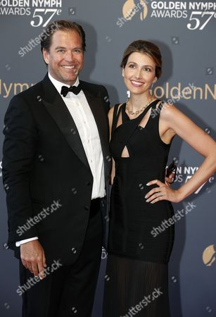 US actor Michael Weatherly (L) and his wife Bojana (R) pose on the red carpet while arriving for the closing ceremony of the 57th Monte Carlo Television Festival in Monaco, 20 June 2017. The event runs from 16 to 20 June.